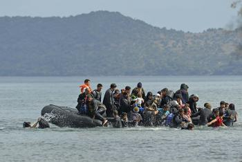 Group of people on a dinghy (Photo © Shutterstock)